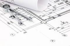 Drawing compass on house plan blueprint closeup Royalty Free Stock Photos