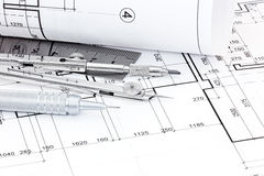 Drawing compass, ruler, pen and graphical architectural plans Stock Photos