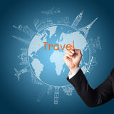 Drawing the concept travel around the world. Business man hand drawing the concept travel around the world Royalty Free Stock Image