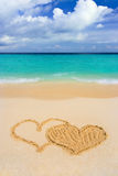 Drawing connected hearts on beach Royalty Free Stock Photo