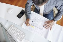 Drawing construction plan. Architect drawing construction plan, view from above stock photo