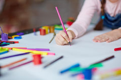 Drawing with crayons Royalty Free Stock Photos
