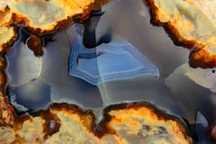 Drawing on a cut of agate. Bright iridescent drawing on a cut of agate Stock Photos