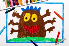 Drawing: Cute brown monster with six hands. Colorful drawing: Cute brown monster with six hands royalty free stock photo