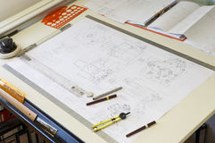 Drawing desk. Engineering drawing on drawing desk with rulers and pencils Stock Photos