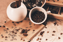 Drawing in diary and cup of coffee beans Royalty Free Stock Photography