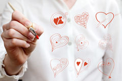 Drawing different love symbols Royalty Free Stock Photo