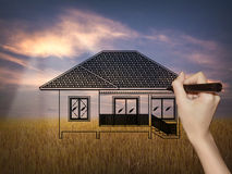Drawing a dream home on nature background Royalty Free Stock Image