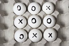 Drawing on eggs - tic-tac-toe game. Draw. Drawing on eggs - tic-tac-toe game Royalty Free Stock Photos