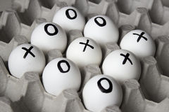 Drawing on eggs - tic-tac-toe game. WIN. Drawing on eggs - tic-tac-toe game Royalty Free Stock Image