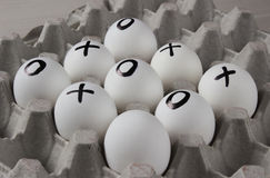 Drawing on eggs - tic-tac-toe game. Win or lose. Drawing on eggs - tic-tac-toe game Royalty Free Stock Photo