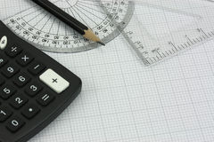 Drawing equipment and calculator Royalty Free Stock Images