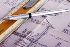 Drawing equipment with detailed architects house plans Royalty Free Stock Photos