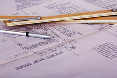 Drawing equipment with detailed architects house plans Royalty Free Stock Photography