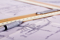 Drawing equipment with detailed architects house plans. Drawing equipment on detailed architects house plans royalty free stock images