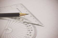 Drawing equipment on graph paper Royalty Free Stock Image