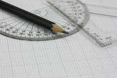 Drawing equipment on graph paper Royalty Free Stock Photo