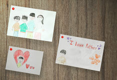 Drawing of family, paper on wood background Stock Photography