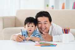 Drawing with father Stock Image