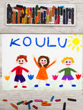 Drawing: Finnish word SCHOOL and happy children. Photo of  colorful drawing: Finnish word SCHOOL and happy children. First day at school Royalty Free Stock Images