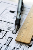 Drawing the floorplan with a pen and ruler. Drawing the floor plan with a pen and a ruler Stock Image
