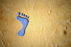 Drawing footprint blue sand Royalty Free Stock Photos