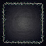 Drawing frame with leaves on chalkboard background Royalty Free Stock Images