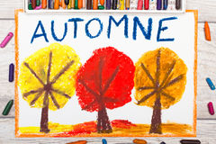 Drawing: French word Autumn and trees with red, yellow and orange leaves Stock Photography