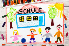 Drawing: German word SCHOOL, school building and happy children. Photo of colorful drawing: German word SCHOOL, school building and happy children. First day at Royalty Free Stock Image