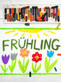 Drawing:  German words Frühling Spring. Colorful drawing:  German words Frühling Spring and beautiful flowers Stock Images