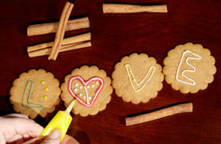 Drawing on ginger cookies. Royalty Free Stock Photos