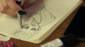 Drawing a girl on paper stock video