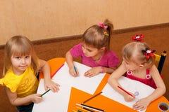 Drawing girls of four Stock Photos
