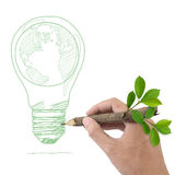 Drawing Globe in a light bulb. Male hand drawing Globe in a light bulb Stock Photography