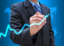 Drawing graph. Businessman hand drawing business graph royalty free stock photo