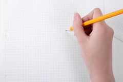 Drawing on graph paper with a pencil Royalty Free Stock Photo