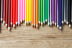 Drawing green pencils on a wooden background Royalty Free Stock Photo