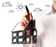 Drawing a growing real estate chart Royalty Free Stock Photos