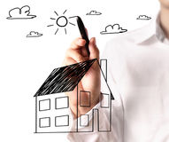 Drawing a growing real estate chart Royalty Free Stock Images
