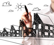 Drawing a growing real estate chart Stock Photos