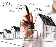 Drawing a growing real estate chart Royalty Free Stock Photo