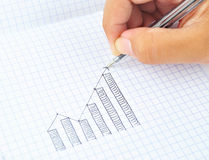 Drawing growth graph of success. With a pen Royalty Free Stock Image