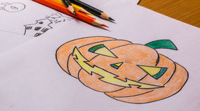 Drawing. Halloween pumpkin shaped by drawing and coloring Royalty Free Stock Images