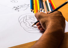 Drawing. Hand of man drawing pumpkin of Halloween by pencil Royalty Free Stock Images