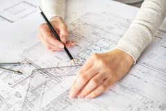 Drawing hands of engineer. Hands of engineer drawing by pencil Royalty Free Stock Photo
