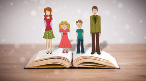 Drawing of a happy family on opened book Stock Image