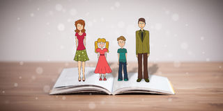 Drawing of a happy family on opened book. The symbol of unity and happiness royalty free stock photo