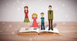 Drawing of a happy family on opened book Royalty Free Stock Photo