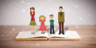 Drawing of a happy family on opened book Stock Photos