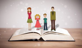 Drawing of a happy family on opened book Stock Photography